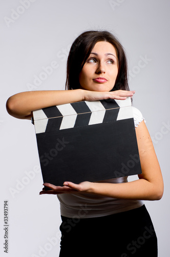 young woman holding a clapper