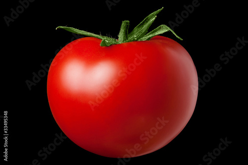 Red tomato on a black background