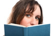 Young girls beautiful green eyes reading a book