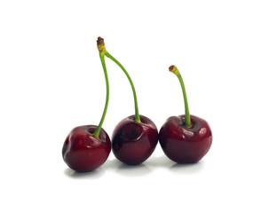 three ripe dark red cherries