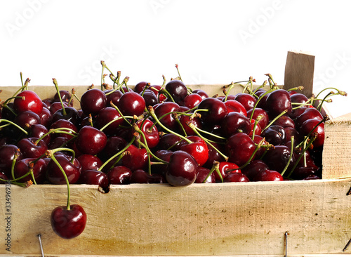 ripe red cherries in a wooden box