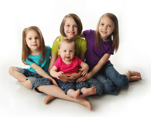 Four young adorable sisters