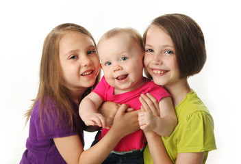 Three cute young sisters