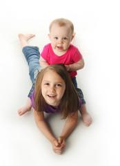 Big sister and baby sister playing