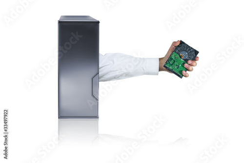 IT professional in PC holding HDD (hard drive).