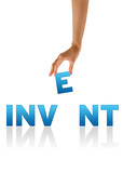 Hand holding E of the word Invent poster