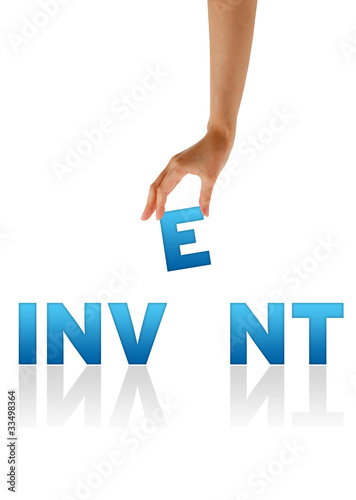 Hand holding E of the word Invent