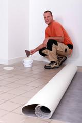 Laborer crouching in kitchen