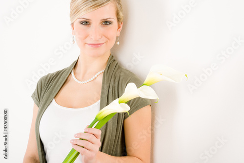 Romantic woman hold calla lily flower purity