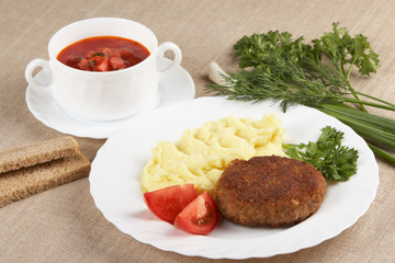Cutlet with mashed potatoes and soup