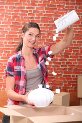 portrait of a woman with moving box