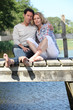 Barefoot couple by the water