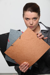 Businesswoman showing files