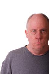 Older Balding Man with grumpy expression