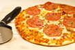 Pepperoni and Sausage Pizza on Board with Cutter