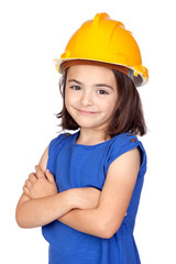Brunette little girl with a yellow helmet