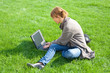 woman grass laptop