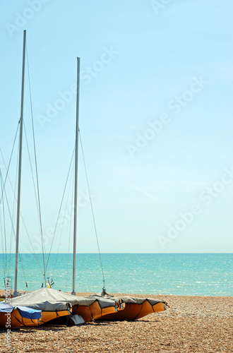 stored sailboats on the beach