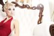 Blond woman sitting on luxury sofa