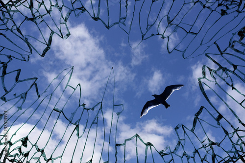 Sky viewed from shattered glass - symbol for freedom