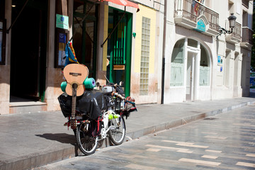 Bicycle with luggage and guitar