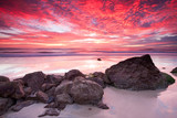 Fototapety australian seascape at sunrise with rich in red color