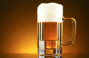 mug of beer on a yellow background