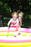 Two Little Girls Playing in Pool Outdoor