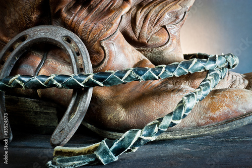 Cowboy  boots,horseshoe and whip on wood - 33524573