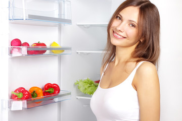 Picking food from fridge