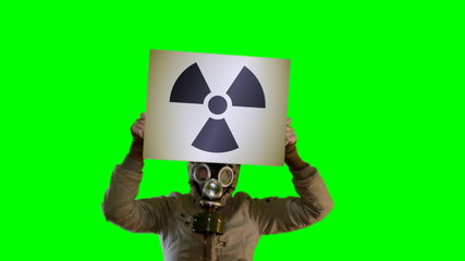 Chroma key anger persons in gas mask with board Radiation