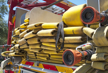 Up close view of a yellow fire hose on a firetruck
