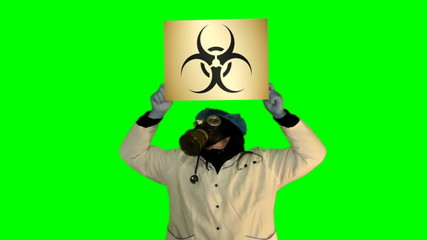 Chroma key anger persons in gas mask with board Biohazard