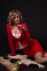 Sensual  lady in red with wine glass in a hand