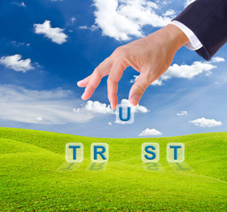 business man hand made trust word buttons