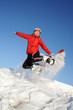 woman jumping with snowboard