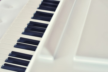 cross processed photograph of white piano