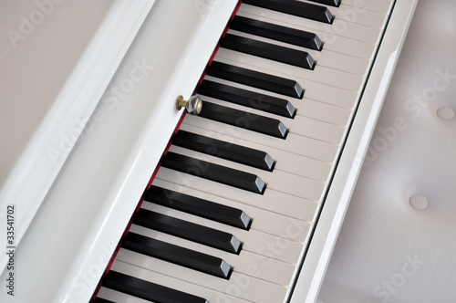 detail of white piano