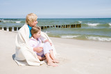 Happy childhood - little girl with mother on the beach poster