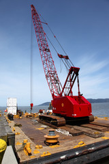 Heavy duty crane on a barge, port of Astoria OR.