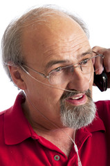 Man wearing a cannula for Oxygen talking on the phone