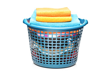 Studio shot of colorful towels in a laundry bin