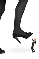Big woman shoe stepping on a businesswoman