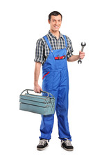 Male manual worker holding a wrench and tool box