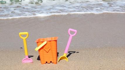 child's bucket and spade on beach