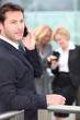 Businessman holding mobile telephone