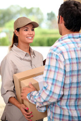 Female courier delivering package