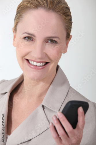 Cheerful woman sending message
