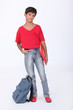 Young schoolboy in a red t-shirt and shoes
