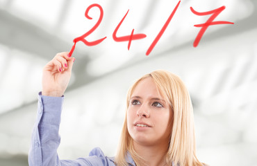 "Woman writing ""24/7"" on the screen"